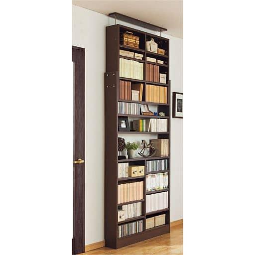 1cm単位で棚板の高さを変えるつっぱり壁面本棚の写真