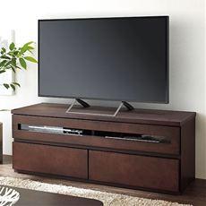 【完成品】幅100cmと120cmの比較的コンパクトな天然木仕様のテレビボードです。スッキリとしたデザインだけでなく、背面にはコード収納を備えています。天板の奥側を欠き取っているので本体を壁付したまま、テレビとデッキの配線が可能です。天然木の上質感も魅力です。