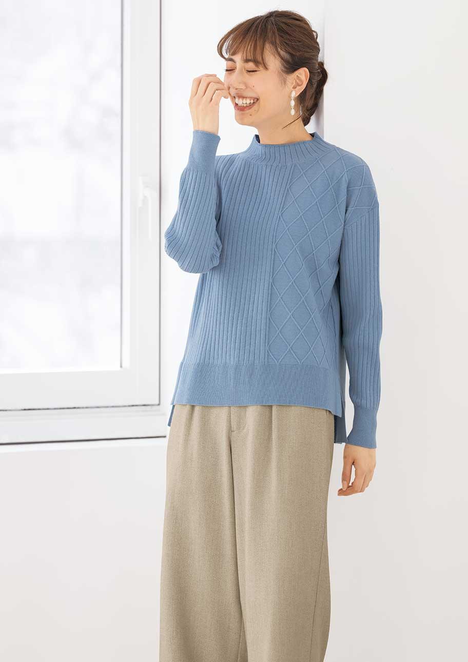 1枚で羽織るだけでサマになる編み地切り替えニットの存在感